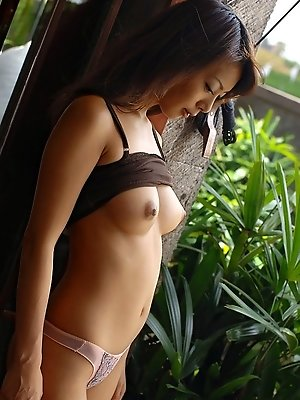 Lovely Asian model enjoys being the object of lust and shows her sexy tits