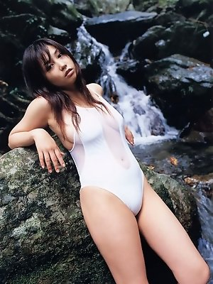 Seductive asian fox in a bikini with big soft round titties