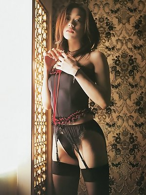 Steamy asian woman heats up the place in her black lacey lingerie